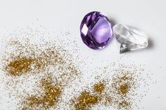 Diamonds close-up. Whit gold powder Stock Image