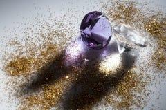 Diamonds close-up. Whit golden powder Stock Photo