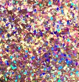 Diamonds. Colored flake diamonds shining in the sun light. Background shapes glitter dots full royalty free stock image