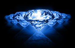 Diamonds on dark background Stock Photo