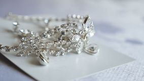 Diamonds decoration lies on the table earrings. wedding earrings are on table. Diamonds decoration lies on table earrings. wedding earrings are on table stock footage