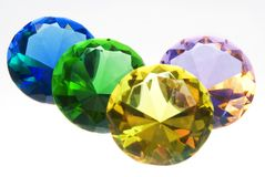 Diamonds are forever. Some colored gemstones on a white backround Royalty Free Stock Photography