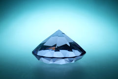 Diamonds are forever. Giant crystal on isolated backgorund with blue backlit stock photo