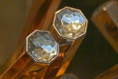 Diamonds on gold bar Stock Photos