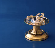 Diamonds On Gold Pedestal Royalty Free Stock Images