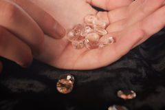 Diamonds in hand Stock Photography
