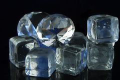 Diamonds and ice. Attractively colored diamonds on ice blocks Stock Photo