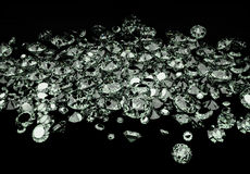 Diamonds. A large number of diamonds scattered on black background Stock Photography