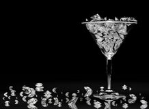 Diamonds in a martini glass Stock Photos