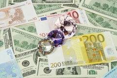 Diamonds and money Royalty Free Stock Photos