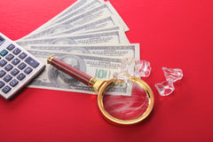 Diamonds and money are on the table Stock Image