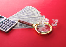 Diamonds and money are on the table Royalty Free Stock Photography