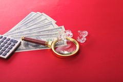 Diamonds and money are on the table Royalty Free Stock Photos