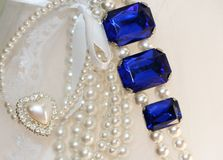 Diamonds n Lace. Pearls and diamonds and antique sapphires on wedding lace Stock Image