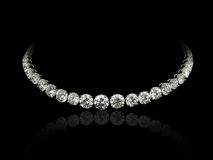 Diamonds necklace. A magnificent round diamonds necklace on black background with reflection Royalty Free Stock Photos