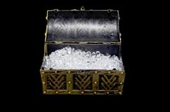Diamonds in an open treasure chest. Open treasure chest full of diamonds royalty free stock photos