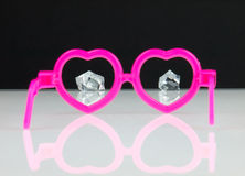 Diamonds and pink glasses. Stock Image