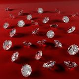 Diamonds on red velvet cloth Stock Image