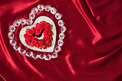 Diamonds and Roses outline a  heart mirror on  Red Satin (P) Royalty Free Stock Photo