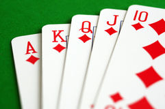 Diamonds royal flush. Poker playing cards, diamonds royal flush over green table Royalty Free Stock Photos