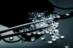 Diamonds scattered on a shiny surface Stock Photos