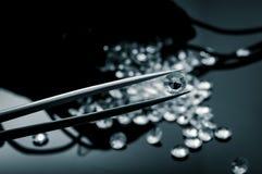 Diamonds scattered on a shiny surface. Black and white image of diamonds scattered on a shiny surface Stock Photos