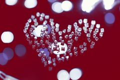 Diamonds in shape of heart on red. Till Valentine`s Day Stock Photography