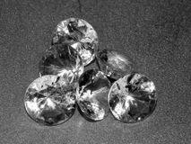 Diamonds on a silver background. Close-up Stock Image
