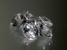 Diamonds on a silver background. Close-up Royalty Free Stock Images
