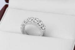Diamonds in silver and gold rings Stock Images