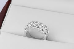 Diamonds in silver and gold rings Royalty Free Stock Image