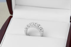 Diamonds in silver and gold rings Royalty Free Stock Photography