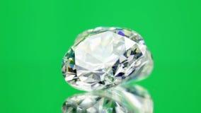 Diamonds spinning on green stock video footage