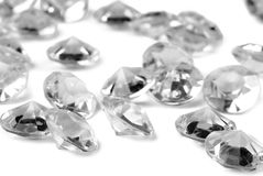 Diamonds on white background. Closeup of the diamonds on white background Stock Images