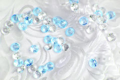 Diamonds on white fabric Stock Photography