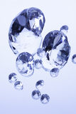 Diamonds on white mirror Stock Photo