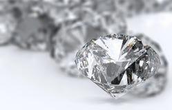 Diamonds on white surface. Diamonds 3d on white surface royalty free stock image