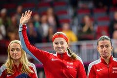 Diana Marcinkevica, Alona Ostapenko i Anastasija Sevastova podczas świat grupy II Round Pierwszy gry, zdjęcia royalty free