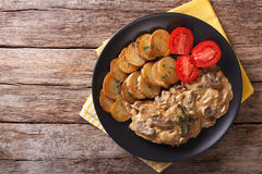 Diana steak garnished with fried potatoes close-up. Horizontal t Stock Image