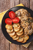 Diana steak with mushrooms and cream sauce close-up. Vertical to Royalty Free Stock Image