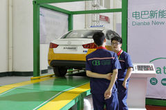 Dianba new energy staff test beijing brand electric taxi Royalty Free Stock Images