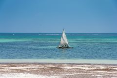 Diani beach in Kenya. Beautiful view of saliboat. stock photography