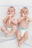 Diaper boys. Two babies wear diapers and lie on a blanket Stock Photos