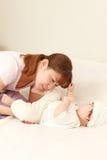 Diaper change. Concept shot of child care stock photos
