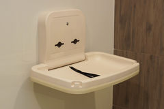 A diaper-changing table. Placed in adult toilet Royalty Free Stock Images