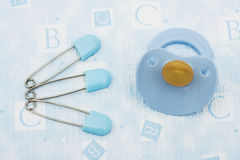 Diaper Pins and Pacifier Royalty Free Stock Photography