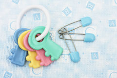 Diaper Pins and Rattle Stock Photography