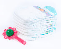Diaper and rattle Stock Photo
