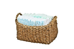 Diapers in basket Royalty Free Stock Photography