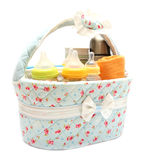 Diapers milk bottle and flask in basket Royalty Free Stock Image